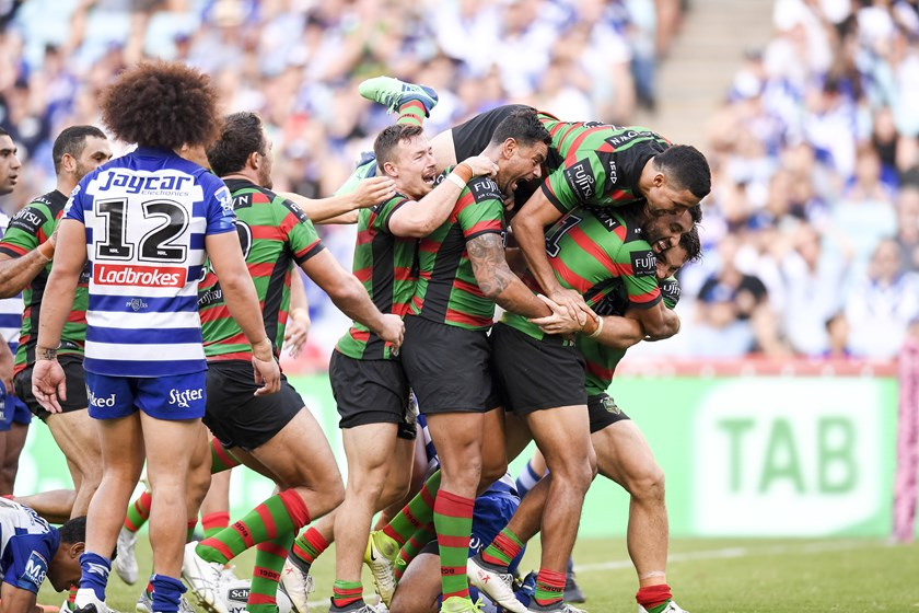 Celebration after Cameron Murray scored the match-winning try on Good Friday.