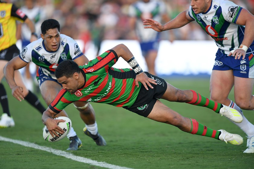 Cody Walker scores one of his four tries for the Rabbitohs against the Warriors.