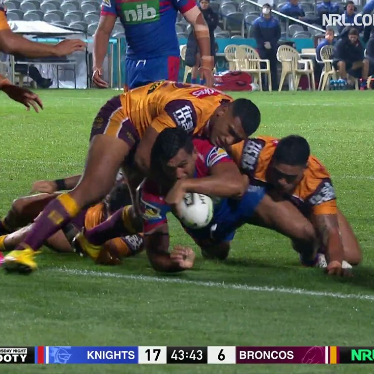 Daniel Saifiti outmuscles several Broncos