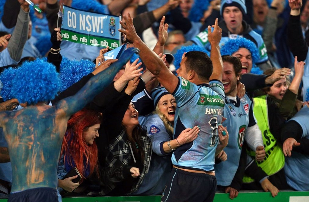 SYDNEY, AUSTRALIA - JUNE 18:  Jarryd Hayne celebrates with fans at the conclusion of game two of the State of Origin series between the New South Wales Blues and the Queensland Maroons at ANZ Stadium on June 18, 2014 in Sydney, Australia.  (Photo by Renee McKay/Getty Images)