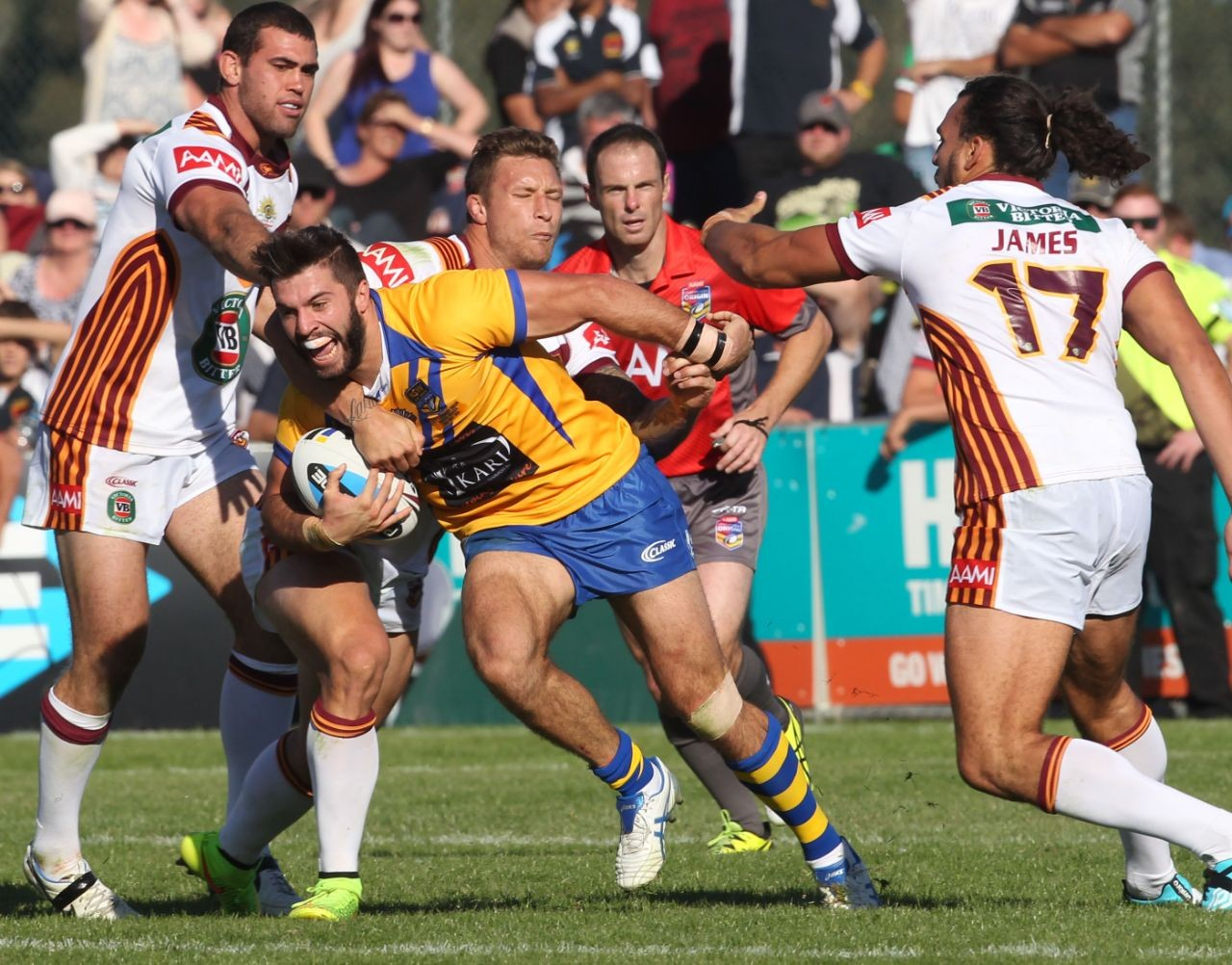 :	Digital Image by Colin Whelan copyright © nrlphotos. James Tedesco grabbed by Tariq Sims		Representative Rugby League, City v Country at Wagga Wagga, Sunday April 3rd 2015.
