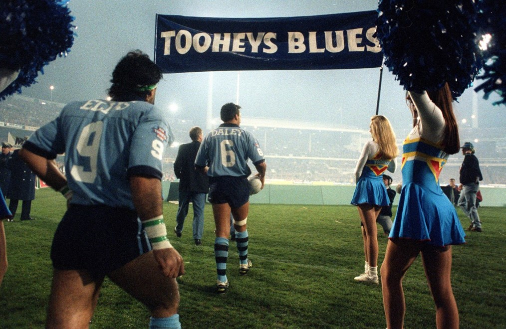 Blues' skipper Laurie Daley leads out the NSW team. 069.0094.551 HAPPY NSW - State of Origin 1994 Series, Game 2 at MCG. Photograph taken on colour negative by Colin Whelan © Action Photographics.