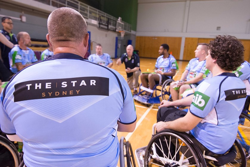 The NSW Wheelchair Rugby League side during a 2016 clash with Queensland.
