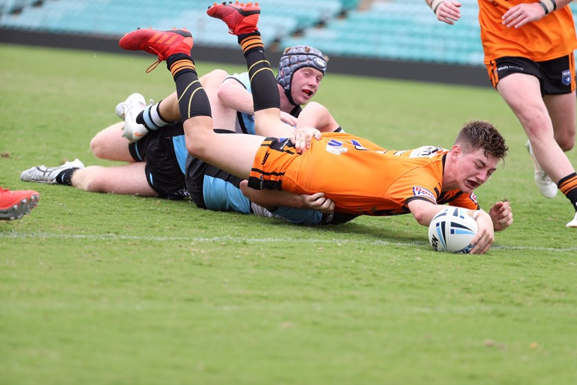 Zane Camroux scores the match-winning try for the Balmain Tigers.