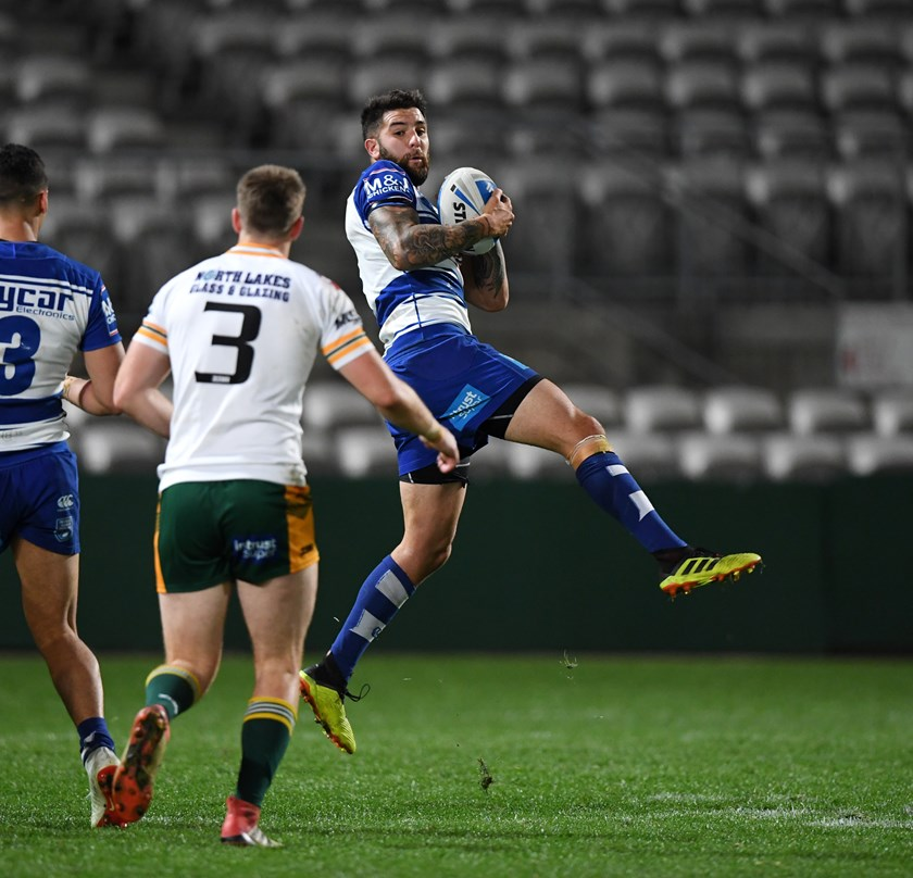 Up Above: Mason Cerruto latches onto a high ball in the Bulldogs' semi-final win over the Wyong Roos