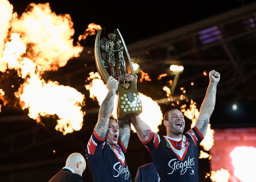 Jake Friend and Boyd Cordner lift the Proven-Summons trophy.