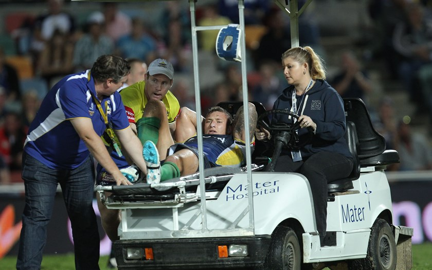 Tariq Sims leaves the field with a broken leg in 2012.