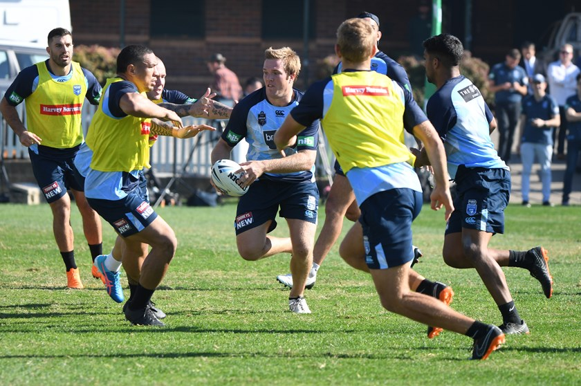Jake Trbojevic looks to get past brother Tom in Brydens Lawyers NSW Blues training.