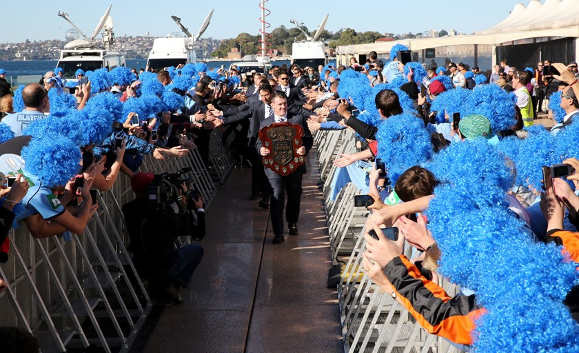 Paul Gallen marches the shield through a sea of Blatchys Blues at a celebratory welcome home at the Sydney Opera House.